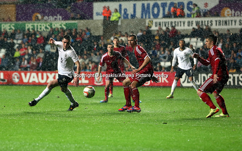 Pictured: Michael Keane of England(L) tries to get past Wales' players. Monday 19 May 2014<br /> Re: UEFA Euro Under-21 Qualifier, Wales v England at the Liberty Stadium, Swansea, south Wales, United Kingdom