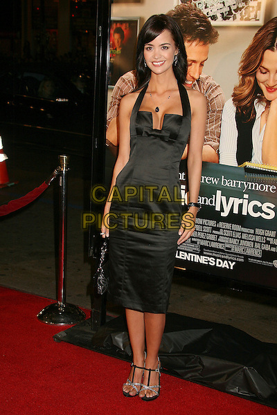 "APRIL SCOTT.""Music and Lyrics"" Los Angeles Premiere at Grauman's Chinese Theatre, Hollywood, California, USA..February 7th, 2007.full length black halterneck satin dress.CAP/ADM/BP.©Byron Purvis/AdMedia/Capital Pictures"