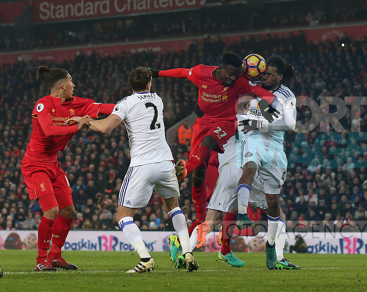 Divock Origi of Liverpool has his header blocked by Jason Denayer of Sunderland during the Premier League match at the Anfield Stadium, Liverpool. Picture date: November 26th, 2016. Pic Simon Bellis/Sportimage