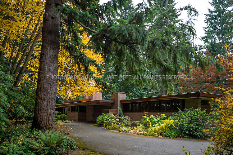 """10/9/2012--Sammamish, WA, USA..VIEW: Exterior showing back of house with main entrance...Architect Frank Lloyd Wright planned his """"Usonian"""" homes to be affordable for middle-class families. The 1,9500 square foot Brandes home is for sale in Sammamish, Washington (30 minutes from Seattle) at $1.39 million. It features three bedrooms, two bathrooms and a small, separate office/study space...The home was built in 1952, and has redwood trim and Wright's original furniture and some garden sculptures by Wright. It's one of only three Frank Lloyd Wright homes near Seattle...©2012 Stuart Isett. All rights reserved."""
