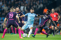 Sergio Aguero of Manchester City tries a shot under pressure from Samuel Umtiti of Barcelona during the UEFA Champions League match between Manchester City and Barcelona at the Etihad Stadium, Manchester, England on 1 November 2016. Photo by Andy Rowland / PRiME Media Images.