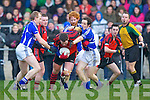 Raymond O'Connor Glenbeigh/Glencar is challenged by Liam Hassett and Pa Sheahan Laune Rangers during the Mid Kerry Championship final in Beaufort on Saturday
