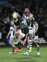 Northampton, England. Ugo Monye of Harlequins and  Ken Pisi of Northampton Saints up for a high ball during the Aviva Premiership match between Northampton Saints and Harlequins at Franklin's Gardens on December 22. 2012 in Northampton, England.