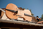 The giant fiddle on the porch roof of the Fiddletown Community Hall during the Old Time Fiddler's jam, Fiddletown, Calif.