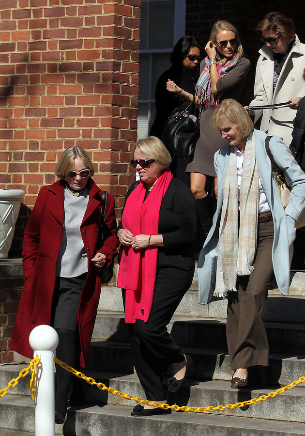 CHARLOTTESVILLE, VA - FEBRUARY 15: Yeardley Love's mother Sharon Love, middle, walks out of the Charlottesville Circuit Courthouse with friends and family during a break from the George Huguely trial. Huguely was charged in the May 2010 death of his girlfriend Yeardley Love. She was a member of the Virginia women's lacrosse team. Huguely pleaded not guilty to first-degree murder. (Credit Image: © Andrew Shurtleff