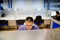 A translator works to translate news programming to Bashkir language at the state-run Telecenter radio and television stations in Ufa, Bashkortostan, Russia.