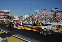 Feb. 14, 2013; Pomona, CA, USA; NHRA top fuel dragster driver Steve Faria races alongside Sidnei Frigo during qualifying for the Winternationals at Auto Club Raceway at Pomona.. Mandatory Credit: Mark J. Rebilas-