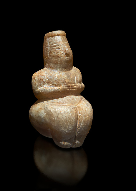 Small Early Neolithic calcareous alabaster  statue of a goddess sitting from Su Cungiau de Marcu, Declomputzu, Sardinia Italy. Museo archeologico nazionale, Cagliari, Italy. (National Archaeological Museum)  - Black Background