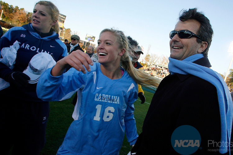 07 DEC 2008:  Head Coach Anson Dorrance of the University of North Carolina celebrates with Rachel Givan (16) and Betsy Frederick (29) after the Tarheels' victory over the University of Notre Dame during the Division I Women's Soccer Championship held at the WakeMed Soccer Park in Cary, NC.  North Carolina defeated Notre Dame 2-1 for the national title.  Jamie Schwaberow/NCAA Photos