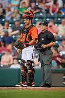 Richmond Flying Squirrels catcher Aramis Garcia (14) in front of home plate umpire Chris Scott during a game against the Trenton Thunder on May 11, 2018 at The Diamond in Richmond, Virginia.  Richmond defeated Trenton 6-1.  (Mike Janes/Four Seam Images)
