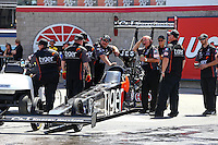 Apr 11, 2015; Las Vegas, NV, USA; Crew members with NHRA top fuel driver Larry Dixon during qualifying for the Summitracing.com Nationals at The Strip at Las Vegas Motor Speedway. Mandatory Credit: Mark J. Rebilas-