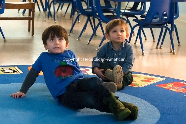 SOUTHBURY, CT--- -011416JS01--Miles Fishbein, 3, left, and his brother Lennox, 1, watch the Disney movie &quot;Frozen&quot; during the Lunch Bunch Indoor picnic and movie Thursday at the Southbury Public Library. <br />  Jim Shannon Republican-American