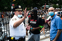 NEW YORK, NEW YORK - June 25: NYPD officers give instructions to protesters of where to march near NYC City hall on June 25, 2020 in New York, NY. Demonstrators are calling for $1 billion in cuts of NYPD, as they protest encampment near City Hall and NYPD headquarters ahead of the city July 1 budget deadline.  (Photo by Eduardo MunozAlvarez/VIEWpress)