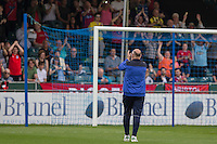 Dagenham & Redbridge manager John Still claps the away fans ahead of the Sky Bet League 2 match between Bristol Rovers and Dagenham and Redbridge at the Memorial Stadium, Bristol, England on 7 May 2016. Photo by Mark  Hawkins / PRiME Media Images.