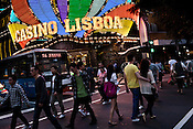 Pedestrians walk past the Casino Lisboa, one of the oldest of Macau's many casinos in Macau, China.