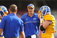STAFF PHOTO ANDY SHUPE - Hot Springs Lakeside coach Jared McBride speaks to his team against Lincoln during the first half of play Monday, Sept. 1, 2014, at Razorback Stadium in Fayetteville.