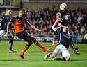 Dundee's James McPake blocks Dundee Utd's Mario Bilate shot.