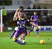 Lincoln City's John Akinde battles with Port Vale's Nathan Smith<br /> <br /> Photographer Andrew Vaughan/CameraSport<br /> <br /> The EFL Sky Bet League Two - Lincoln City v Port Vale - Tuesday 1st January 2019 - Sincil Bank - Lincoln<br /> <br /> World Copyright © 2019 CameraSport. All rights reserved. 43 Linden Ave. Countesthorpe. Leicester. England. LE8 5PG - Tel: +44 (0) 116 277 4147 - admin@camerasport.com - www.camerasport.com