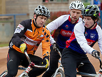 19 APR 2015 - IPSWICH, GBR - Lewis Roberts (right) of Ipswich Eagles fights to hold off Andy Angell (left) of Sheffield Stars during the two teams Elite League cycle speedway fixture at Whitton Sports and Community Centre in Ipswich, Suffolk, Great Britain (PHOTO COPYRIGHT © 2015 NIGEL FARROW, ALL RIGHTS RESERVED)