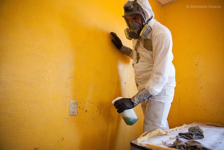 "Donovan using one of the 370 customized formulas which he has devised to carry out the forensic cleaning of the scene of an unsolved homicide in Cuernavaca, Morelos – one of Mexico's most dangerous cities on August 7, 2015. The 66-year-old victim was a retired economics lecturer from the local university, and was killed in January of this year. The cleanup took place eight months later. The victim's family has since moved away to avoid further trouble. They remarked that justice is slow in Mexico and expressed dissatisfaction with the police investigation, but appreciated Donovan's discretion and professionalism. Donovan Tavera, 43, is the director of ""Limpieza Forense México"", the country's first and so far the only government-accredited forensic cleaning company. Since 2000, Tavera, a self-taught forensic technician, and his family have offered services to clean up homicides, unattended death, suicides, the homes of compulsive hoarders and houses destroyed by fire or flooding. Despite rising violence that has left 70,000 people dead and 23,000 disappeared since 2006, Mexico has only one certified forensic cleaner. As a consequence, the biological hazards associated with crime scenes are going unchecked all around the country. Photo by Bénédicte Desrus"