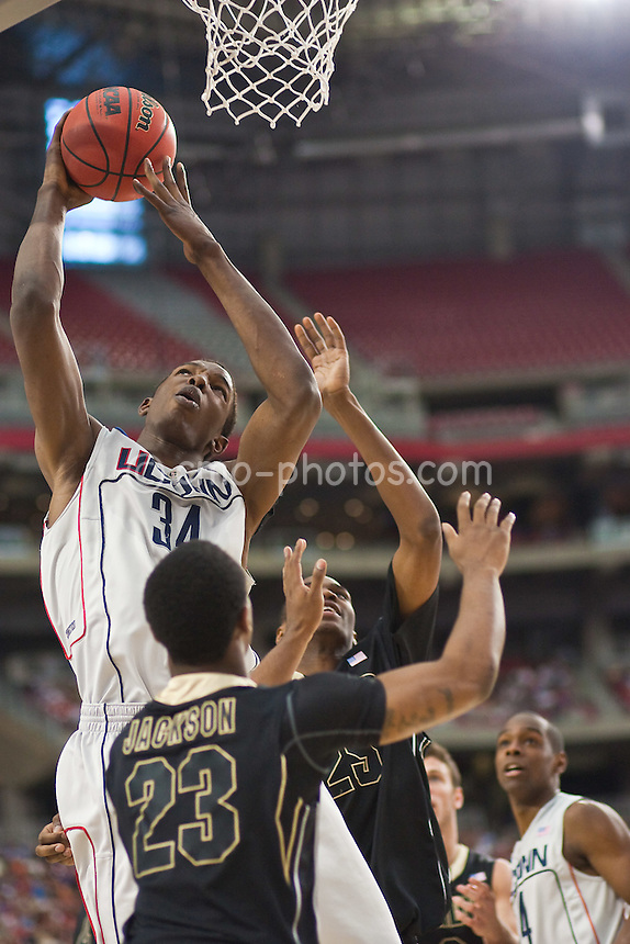 Mar 26, 2009; Tucson, AZ, USA; Connecticut Huskies center Hasheem Thabeet (34) shoots over Purdue Boilermakers guard Lewis Jackson (23) in the second half of a game in the semifinals of the west region of the 2009 NCAA basketball tournament at University of Phoenix Stadium.    UConn defeated Purdue 72-60.