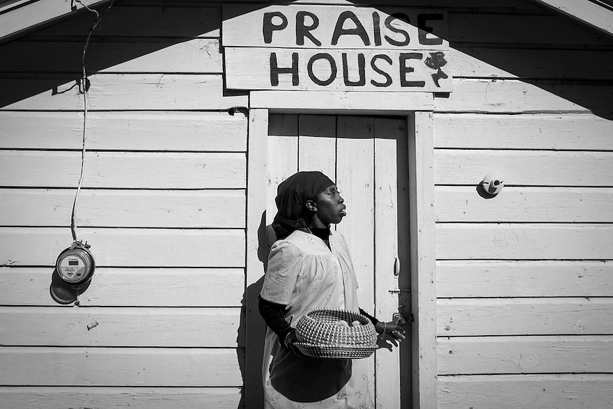 Queen Quet Marquetta L. Goodwine, Chieftess of the Gullah/Geechee Nation stands outside of one of the three remaining praise houses on St. Helena Island, S.C. Built during slavery, they were small places of worship for the Gullah and still serve an important spiritual role in the Gullah community.