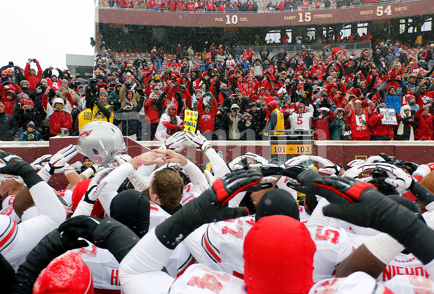 "Ohio State Buckeyes players celebrate with fans during the singing of ""Carmen Ohio"" after beating Minnesota Golden Gophers at TCF Bank Stadium in Minneapolis, Minn. on November 15, 2014.  (Dispatch photo by Kyle Robertson)"