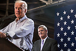 Vice President Joe Biden, flanked by Secretary of Agriculture Tom Vilsack, speaks at a campaign rally at the Port of Burlington during a two-day campaign swing through Iowa on Monday, September 17, 2012 in Burlington, IA.
