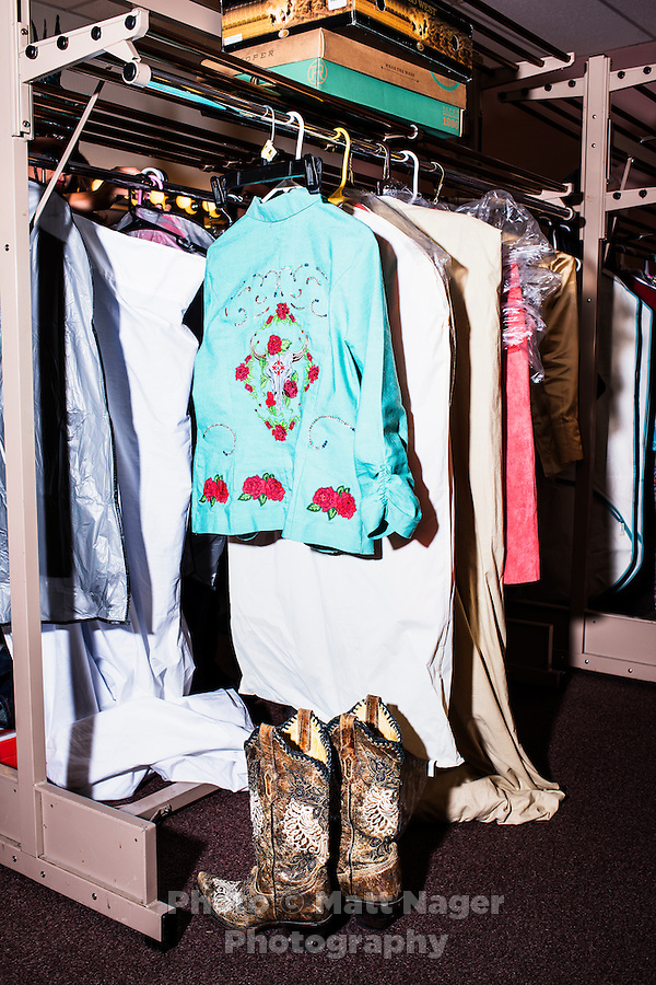 Miss Rodeo Colorado clothes backstage during the fashion show part of the competition at the Greely Stampede in Greely, Colorado, July 3, 2015.<br /> <br /> Photo by Matt Nager