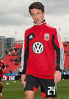 06 October 2012: D.C. United midfielder Lewis Neal #24 coming off the pitch after warm-up in an MLS game between D.C. United and Toronto FC at BMO Field in Toronto, Ontario..D.C. United won 1-0..