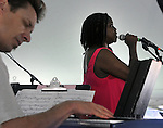 Adam Klipple plays keyboards, while Carla Cook sings, during the performance by the Craig Harris Group at the Annual Jazz in the Valley Festival,  in Waryas Park in Poughkeepsie, NY, on Sunday, August 21, 2016. Photo by Jim Peppler. Copyright Jim Peppler 2016 all rights reserved.