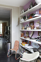 Shelves displaying an eclectic mix of items have been brought to life with a coat of cyclamen paint