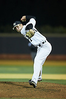 Wake Forest Demon Deacons relief pitcher Antonio Menendez (27) in action against the Florida State Seminoles at David F. Couch Ballpark on March 9, 2018 in  Winston-Salem, North Carolina.  The Seminoles defeated the Demon Deacons 7-3.  (Brian Westerholt/Four Seam Images)
