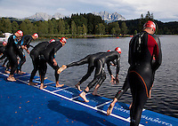15 AUG 2010 - KITZBUEHEL, AUT - Competitors dive into the water at the start of the mens 2010 European Police Triathlon Championships .(PHOTO (C) NIGEL FARROW)