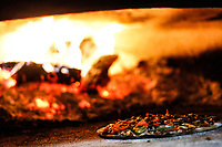 Pizza baked in wood. Pizza. Italian food..<br /> Piza horneada a la leña. Pizza. Comida italiana.