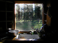 View from a cabin in the woods near Glacier Park, Montana. Photo by Jason Cohn