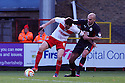 Greg Tansey of Stevenage holds off David Hunt of Crawley. Stevenage v Crawley Town - npower League 1 -  Lamex Stadium, Stevenage - 15th December, 2012. © Kevin Coleman 2012..