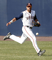 Virginia outfielder Robert Bennie (16) goes after a ball during the game against James Madison University Tuesday in Charlottesville, VA.  Photo/The Daily Progress/Andrew Shurtleff