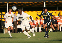 Bright Dike #9 of the University of Notre Dame heads the ball away from Julian Robles #3 of the University of Michigan during a men's NCAA match at the new Alumni Stadium on September 1 2009 in South Bend, Indiana. Notre Dame won 5-0.
