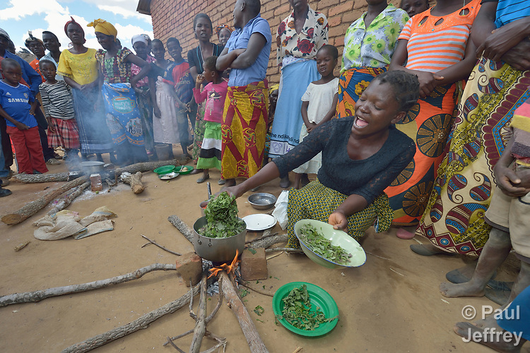A woman gives a cooking demonstration in Kalikumbi, Malawi, part of an educational program promoting good health and nutrition. The Maternal, Newborn and Child Health program of the Livingstonia Synod of the Church of Central Africa Presbyterian has helped families in this village to stay healthy.