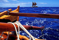 Polynesian voyaging canoes, Hokulea (background) and Hawaiiloa (in foreground) in open ocean off the island of Oahu
