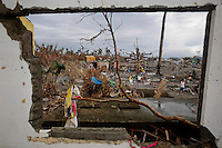 Members of a fishing community are seen collecting water from inside a destroyed school in Tanauan November 20, 2013. The Philippines and international armed forces and aid agencies are struggling to get help to devastated areas due to the extent of the destruction from Typhoon Haiyan, which has left more than 4,000 dead and 4 million people displaced.