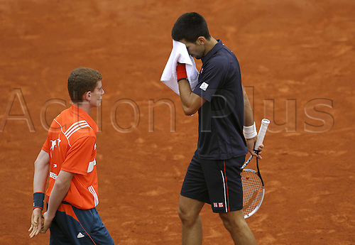 10.06.2012. Roland Garros, Paris, France.  ATP French Open 2012 Paris France Mens World Tour Grand Slam Roland Garros French  Open Final Djokovic wipes rain off face during the final