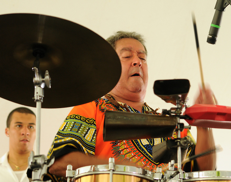 Percussionist, Nicky Marrero, performing with the Zon del Barrio Orchestra, at the 2014 Jazz in the Valley Festival held in Waryas Park on the Hudson River front in Poughkeepsie, NY on Sunday August 17, 2014. Photo by Jim Peppler. Copyright Jim Peppler 2014 all rights reserved.