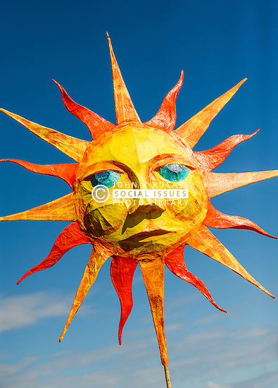 A papier mache representation of the sun in the Penryn Festival in Cornwall