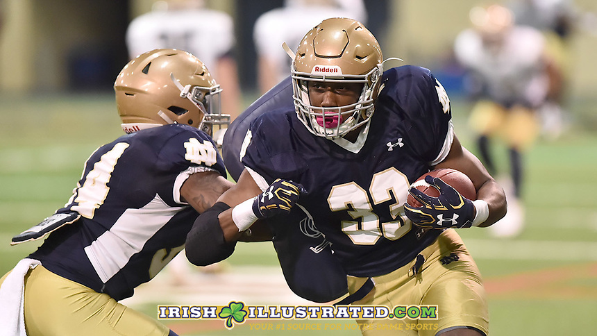 Running back Josh Adams (33)
