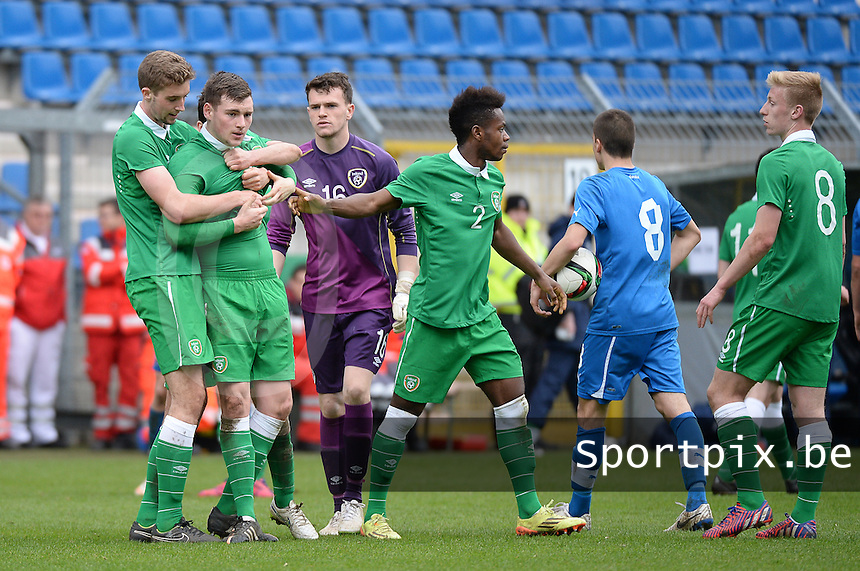 20150331 - MANNHEIM, Germany :<br /> <br /> Irish Kevin Toner (5) has to be calmed by Irish Kelleher Fiacre (Left)  and Irish captain Noe Baba (2) and Irish goalkeeper Harry Doherty (16) after an attack from Slovakian Lukas Cmelik (13)  pictured during the soccer match between Under 19 teams of Republic of Ireland and Slovakia , on the third and last matchday  in Group 2 of the UEFA Elite Round Under 19 at the Carl-Benz Stadium, Mannheim, Germany<br /> <br /> Thursday 31 march 2015<br /> foto Dirk Vuylsteke / David CATRY