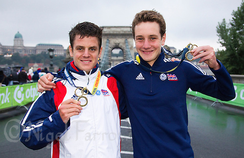 11 SEP 2010 - BUDAPEST, HUN - Brothers Jonathan Brownlee and Alistair Brownlee celebrate their respective victories in the 2010 ITU World Under 23 Mens Triathlon Championships and the 2010 Elite Mens ITU World Championship Series Triathlon final .(PHOTO (C) NIGEL FARROW)