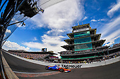 Scott Dixon, Chip Ganassi Racing Honda crosses the finish line under the checkered flag in third place