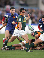 South African centre Francois Hougaard kicks up-field the tackle from French full back Mathieu Belie during the Division A U19 World Championship clash at Ravenhill.